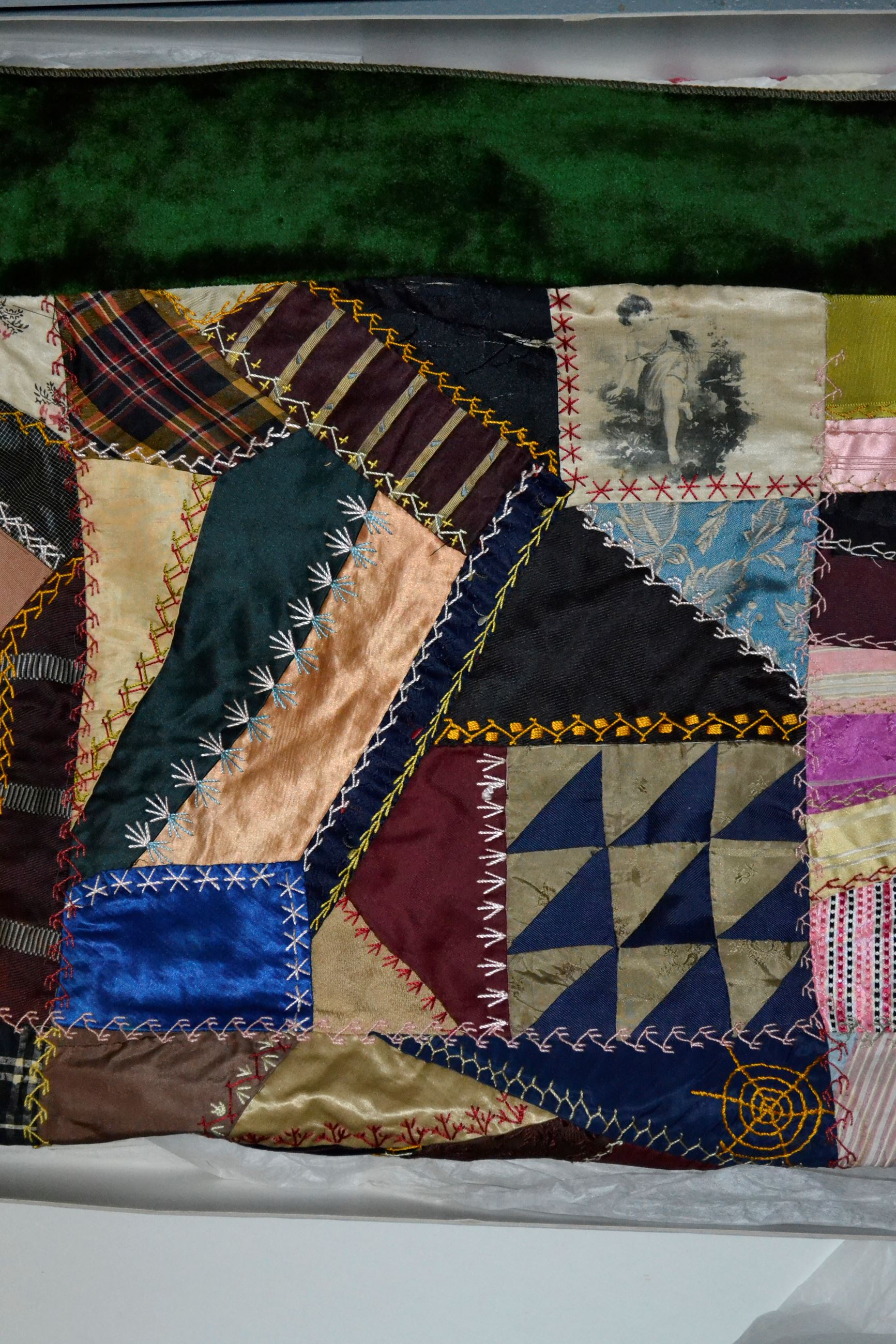 Crazy Quilt- made by Ruth Lamphrey Cadle- c1880 Gift of Mrs Mauree P Mahin and family